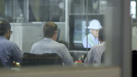 ls ds executives participating in a video conference - work helmet stock videos & royalty-free footage