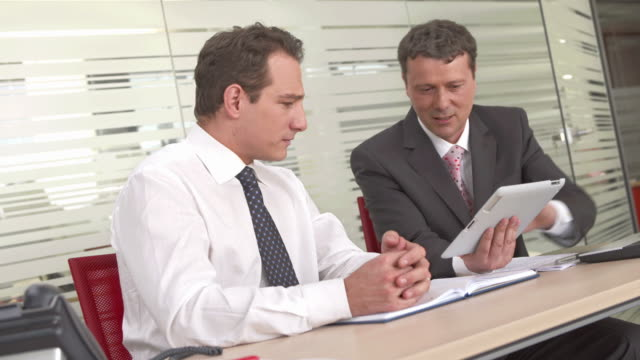 HD: Executives Using Digital Tablet For Business