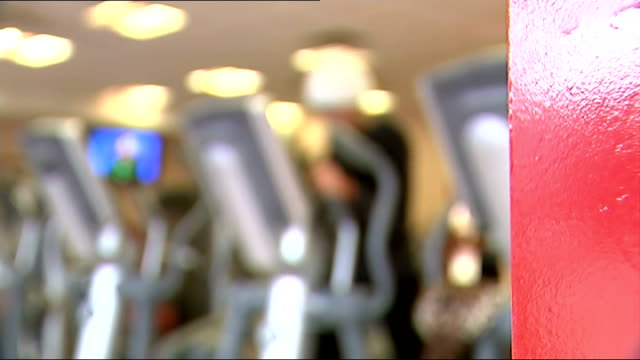 exercise class and gym; more of exercise class / running machines / treadmills in gym / woman on cross country ski machine / elderly man on cycling... - man and machine stock videos & royalty-free footage