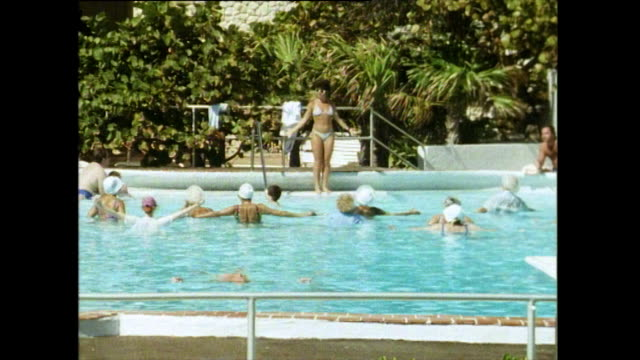exercise class in a swimming pool; miami, 1991 - showing stock videos & royalty-free footage