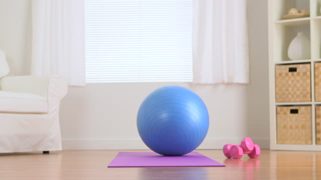 exercise equipment in living room - fitness ball stock videos & royalty-free footage
