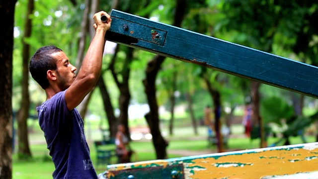 exercise in park. male lifting weight public outdoor gym thailand - hand weight stock videos & royalty-free footage