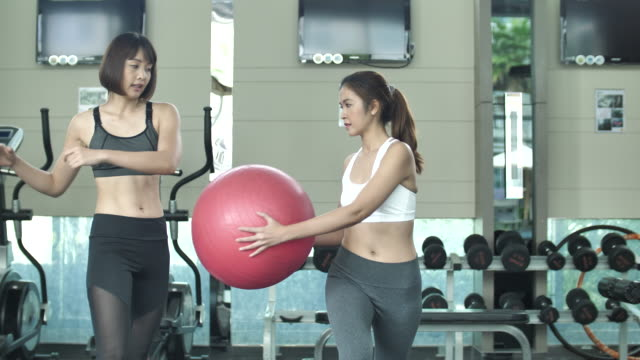 exercise on ball yoga with female trainer - pallone per fitness video stock e b–roll