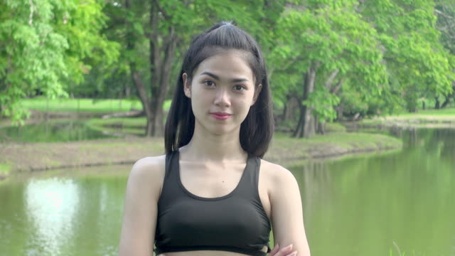 exercise woman in the park - black hair stock videos & royalty-free footage