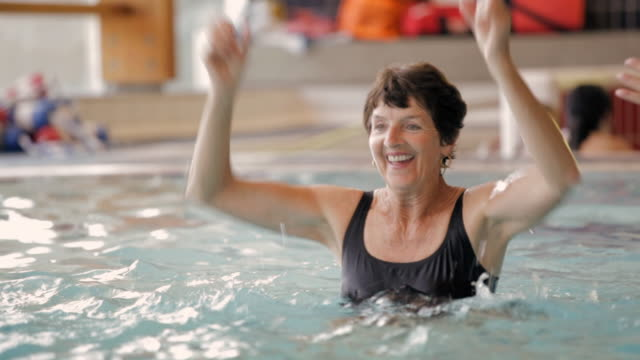 tu exercisers doing water aerobics in pool / vancouver, british columbia, canada - vitality stock videos & royalty-free footage