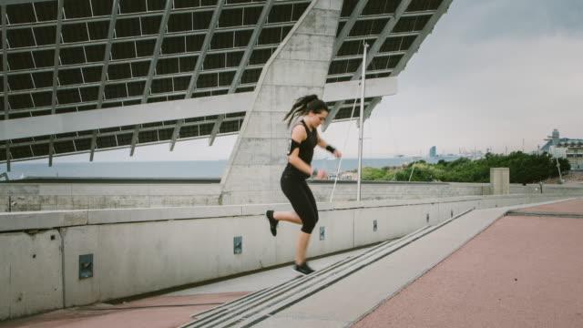 exercises on the steps - auf einem bein stock-videos und b-roll-filmmaterial