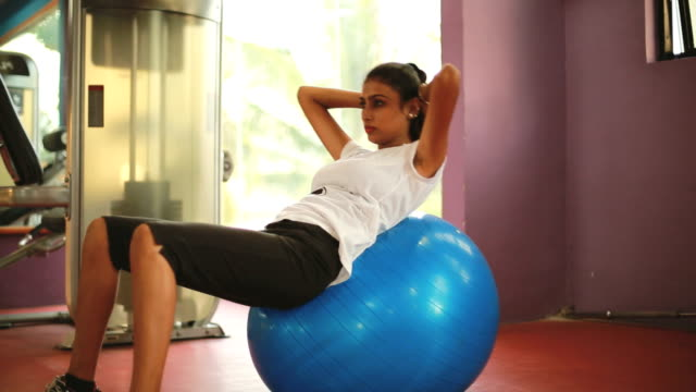 exercises with gym ball - fitness ball stock videos & royalty-free footage