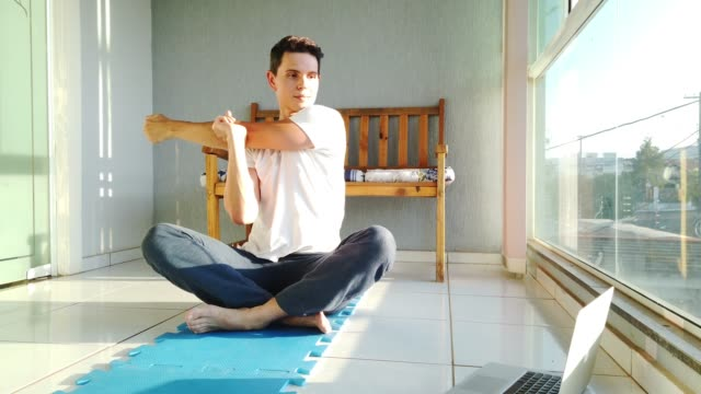 exercising at home - stretching stock videos & royalty-free footage