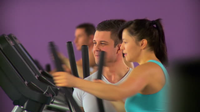 hd: exercising at the gym - cross trainer stock videos and b-roll footage