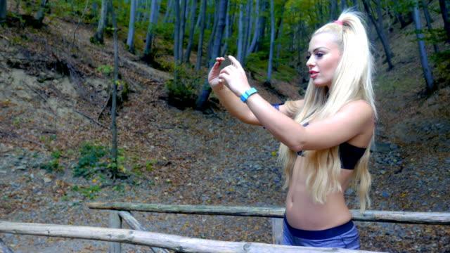 Exercising fitness girl taking selfies outdoors