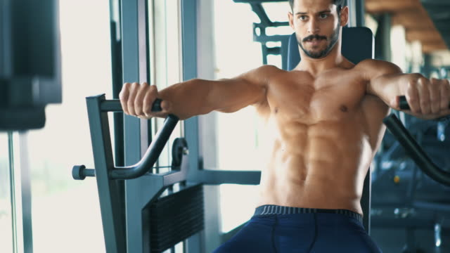 exercising in a gym. - muscular contraction stock videos and b-roll footage