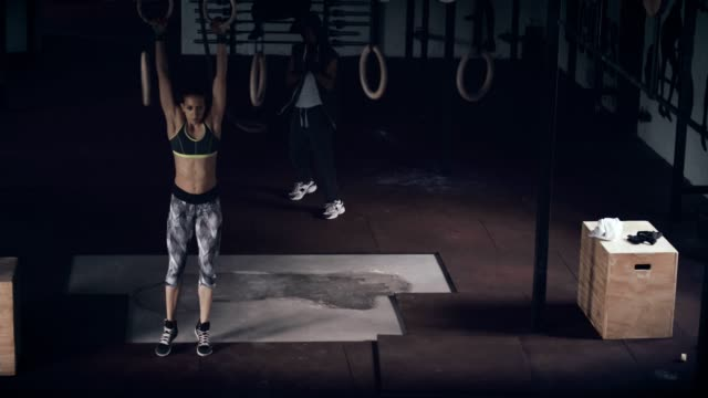exercising in gym - gymnastic rings stock videos & royalty-free footage