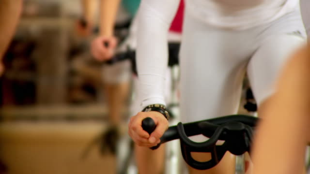 stockvideo's en b-roll-footage met hd: exercising on exercising bikes - cardiovasculaire training