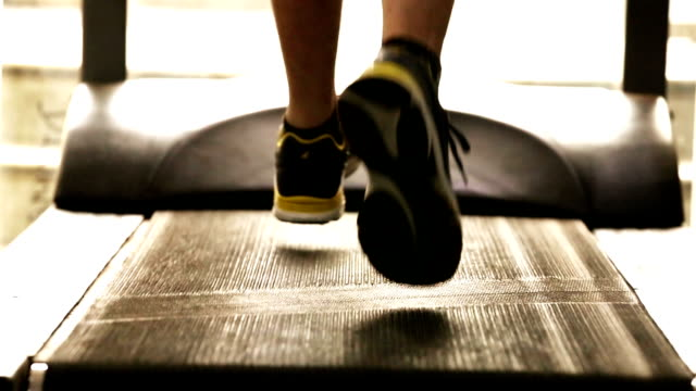 exercising on treadmill - health club stock videos & royalty-free footage