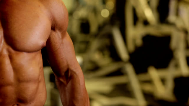 exercising the biceps - flexing muscles stock videos & royalty-free footage