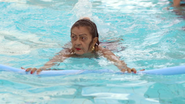 exercising the body in the swimming pool - 70 79 years stock videos and b-roll footage