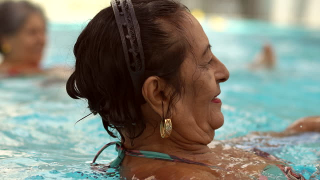 exercising the body in the swimming pool - active seniors stock videos & royalty-free footage