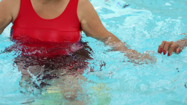 exercising the body in the swimming pool - 70 79 years stock videos & royalty-free footage
