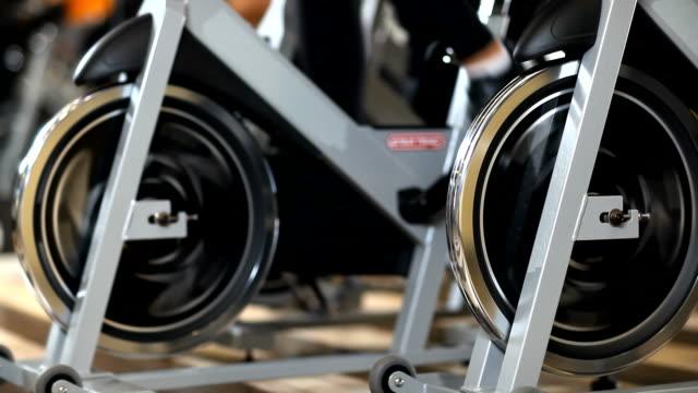 exercising wheels - exercise bike stock videos & royalty-free footage