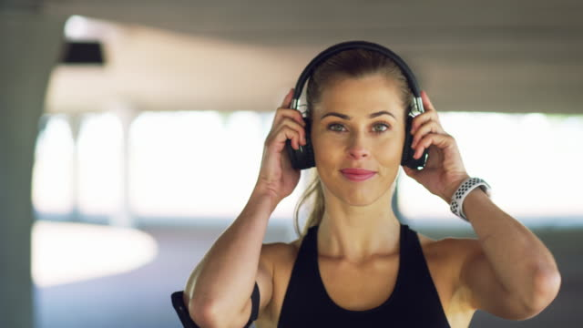 exercising with music can help you get through a tough workout - self discipline stock videos & royalty-free footage
