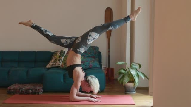 exercising yoga - yoga video stock e b–roll
