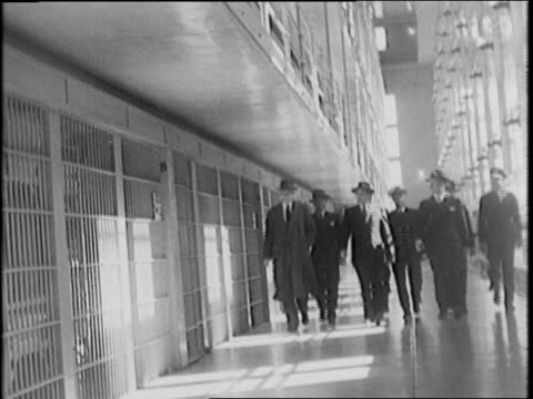 exerior view of prison / group of people entering the prison / us attorney general francis j biddle arrives, view of group moving though cell blocks... - 1942 stock videos & royalty-free footage