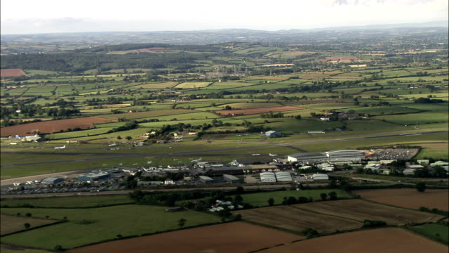 exeter airport - aerial view - england, devon, east devon district, united kingdom - exeter england stock videos & royalty-free footage
