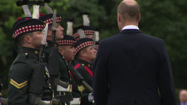 stockvideo's en b-roll-footage met exeterior shots of the duke of cambridge inspecting the guard of honour and band at the ceremony of the keys on 22nd may 2021, united kingdom - clean