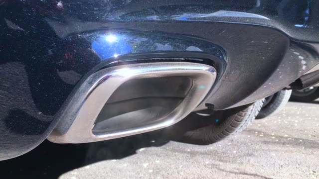 Exhaust Pipe of a Car with Fumes