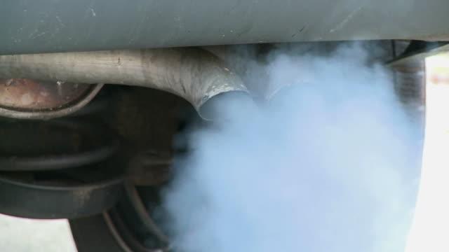 CU Exhaust pipes of car and fumes / Taben, Rheinland-Pfalz, Germany