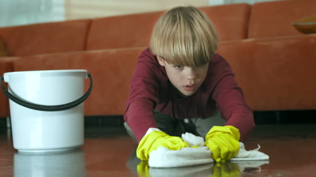 hd: exhausted boy scrubbing the floor - chores stock videos & royalty-free footage