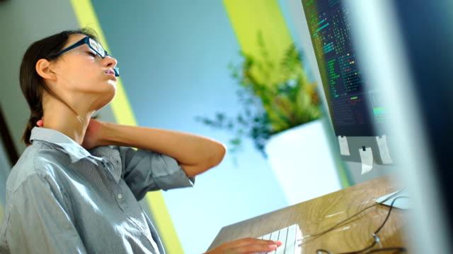 vídeos de stock e filmes b-roll de exhausted by office work. - dor no pescoço