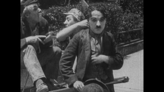1915 exhausted cart horse charlie chaplin struggles to pull boss and second man along road - slapstick comedy stock videos & royalty-free footage