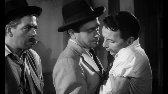 1955 Exhausted delaer (Frank Sinatra) gets direction from his boss