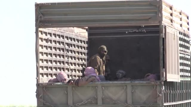 exhausted families trudge out of the islamic state group's last bastion in eastern syria as kurdish led forces boxed holdout jihadists into an... - kurdischer abstammung stock-videos und b-roll-filmmaterial