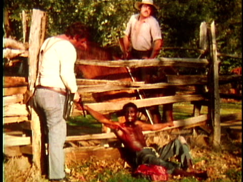 1971 reenactment ws exhausted slave being captured by two bounty hunters on horseback / 19th century united states / audio - runaway stock videos & royalty-free footage