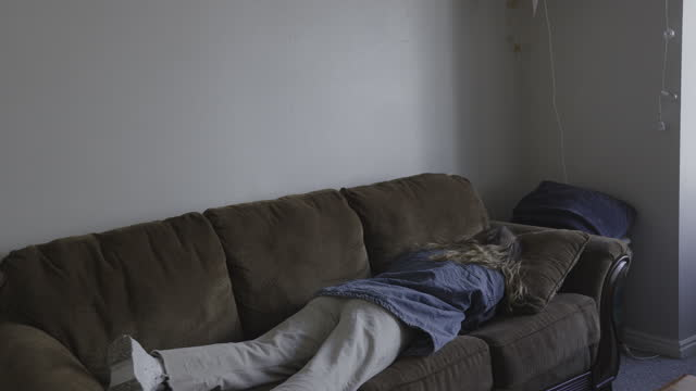 exhausted woman arriving home and collapsing on sofa / provo, utah, united states - negative emotion stock videos & royalty-free footage