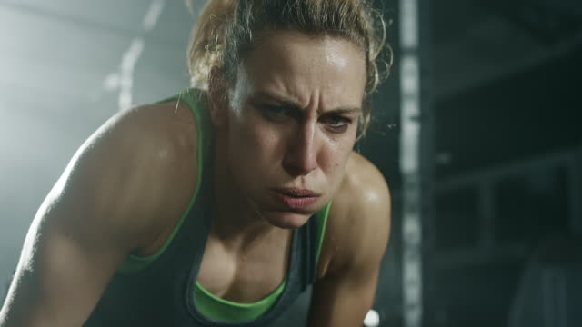 exhausted young women after intense exercise in gym - hoozone stock videos and b-roll footage