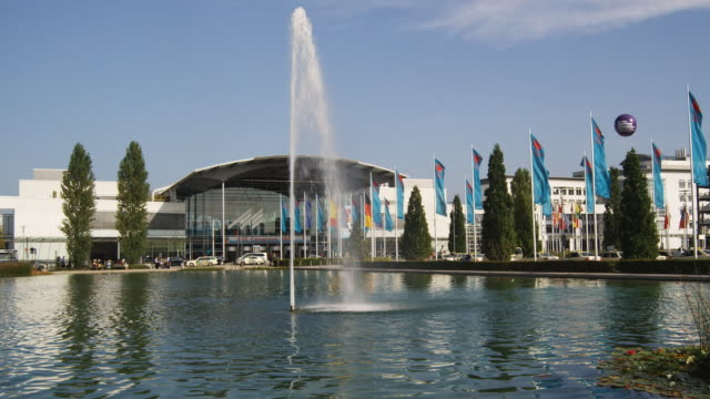 ws, pan, exhibit hall entrance across pond, munich, germany - tradeshow stock videos & royalty-free footage