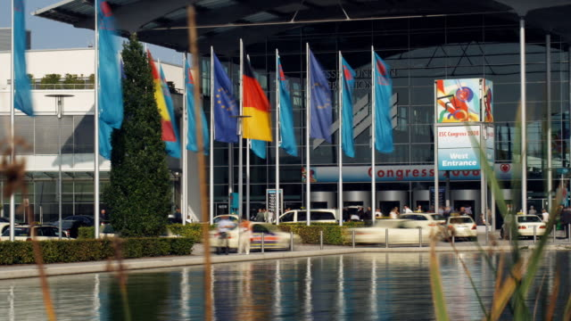 t/l, ms, pan, exhibit hall entrance across pond, munich, germany - messen stock-videos und b-roll-filmmaterial