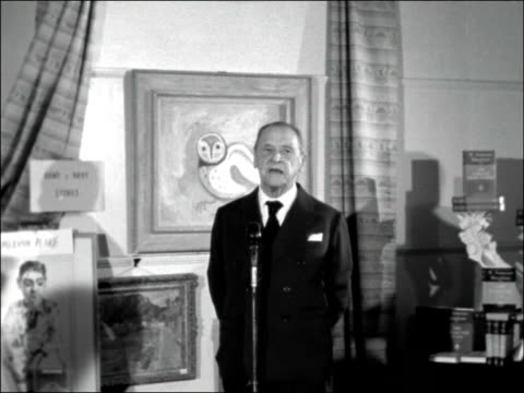 vídeos de stock, filmes e b-roll de exhibition authors as artists opened by somerset maugham england london victoria street int somerset maugham along to microphone for speech sof... - mervyn peake