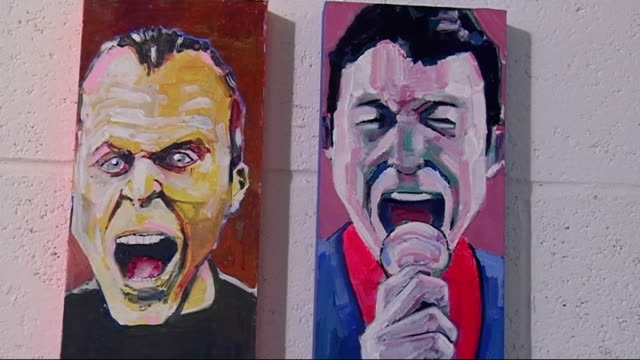Exhibition by actor Christopher Ellison Paintings of singers / painting of Sir Michael Caine and Phil Tufnell on wall / painting of Sir Michael Caine