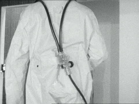 exhibition of protective clothing; england: london: earls court: int man demonstrating thermofoil suit: girl demonstrates combined respirator and... - striped stock videos & royalty-free footage