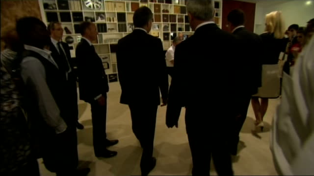exhibition of royal warrant holders to mark anniversary of coronation prince charles along through gardens and chatting with guests/ queen elizabeth... - veneers stock videos and b-roll footage
