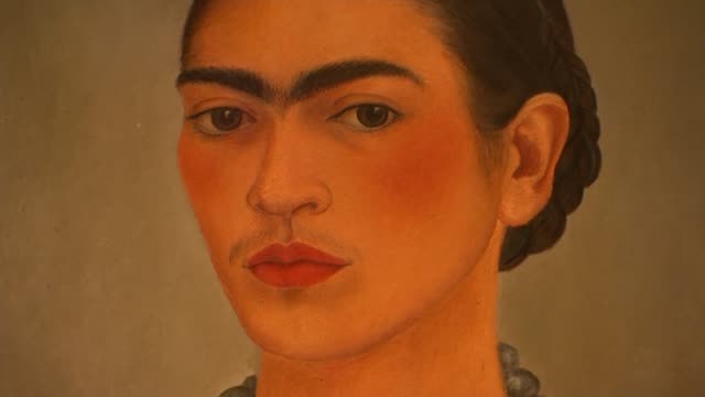 exhibition of the personal items of mexican artist frida kahlo opens in london; england: london: victoria and albert museum: int self portrait of the... - museum stock videos & royalty-free footage