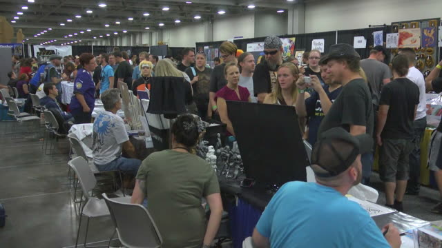 Exhibitors talking with patrons at the first annual comic con in Salt Lake City Utah