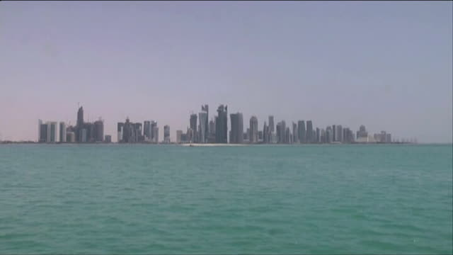 exiled former taliban leader speaks of hopes for peace talks; t20061330 qatar: doha: ext skyscrapers lining waterfront skyscrapers - 追放点の映像素材/bロール