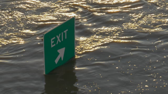 exit sign, barely visible above trinity river flood waters, dallas, texas - exit sign stock videos & royalty-free footage