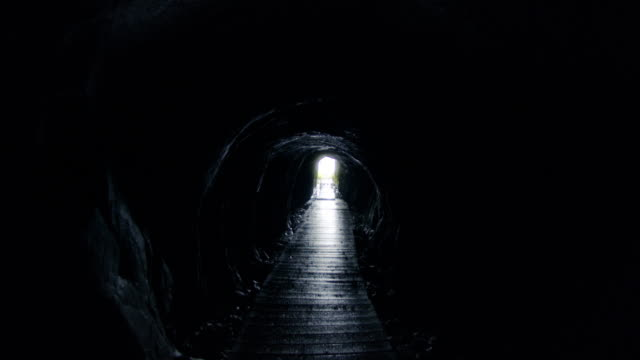 exiting a creepy abandoned cave mine - mining natural resources stock videos & royalty-free footage