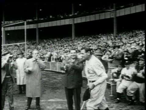 stockvideo's en b-roll-footage met exiting dugout / hugging ed barrow and shaking his hand / taking swing at home plate - 1949